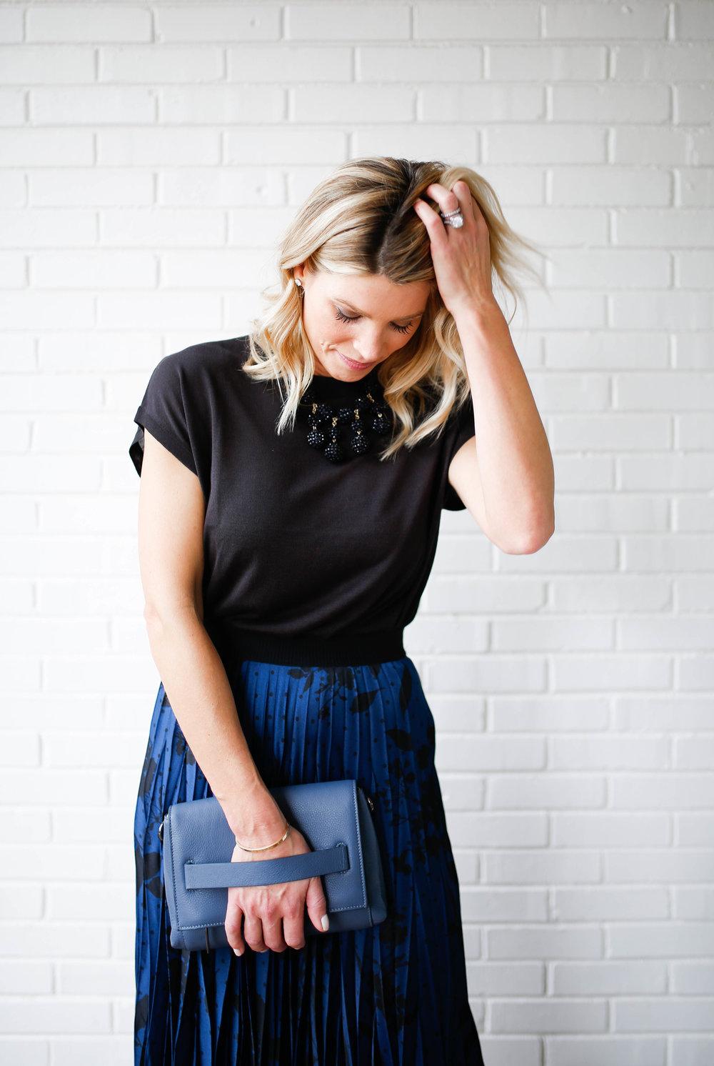 looking down skirt hand in hair.jpg