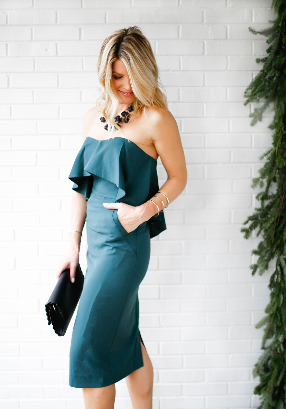 turned to side looking down green dress.png