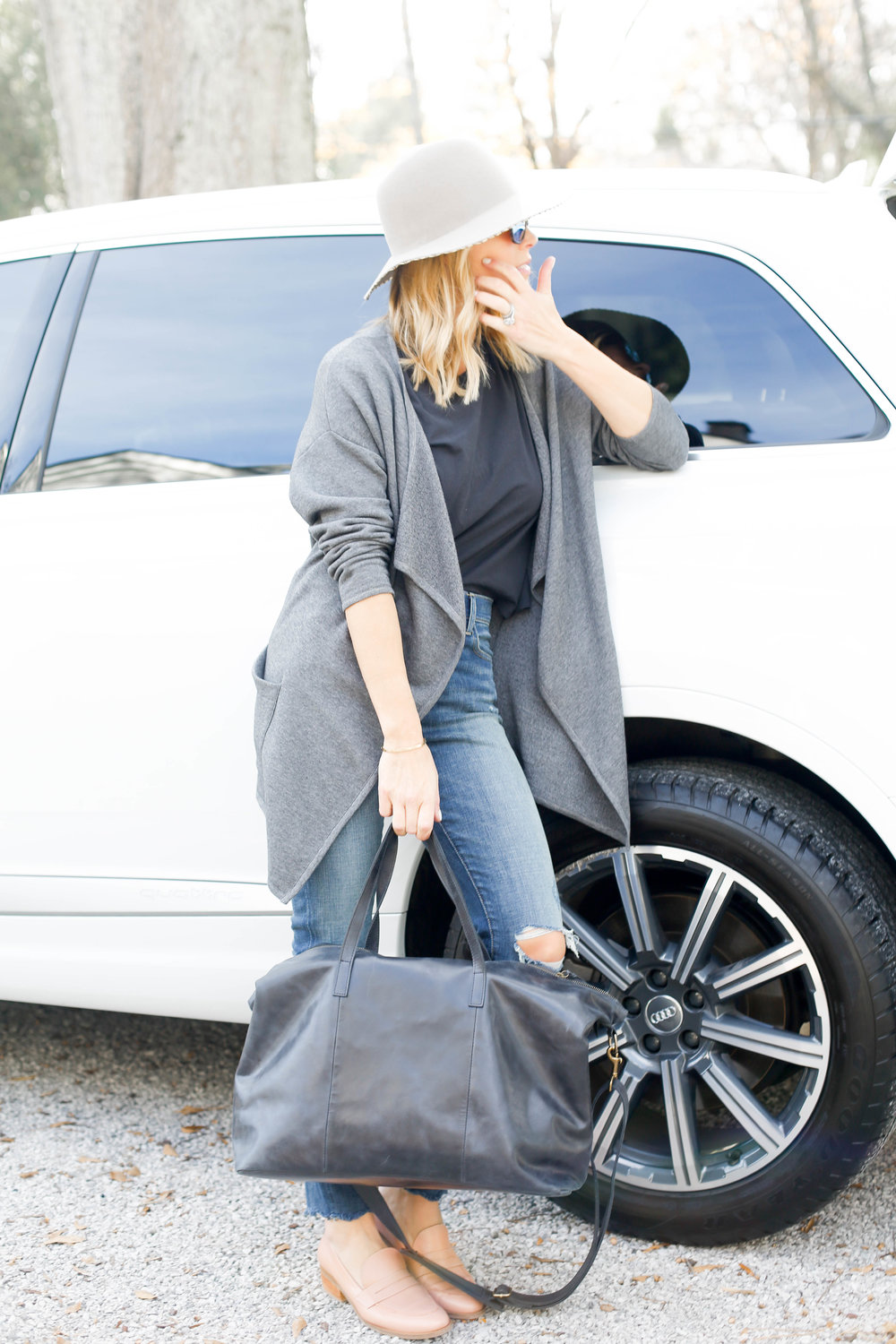leaning up against car with bag.jpg