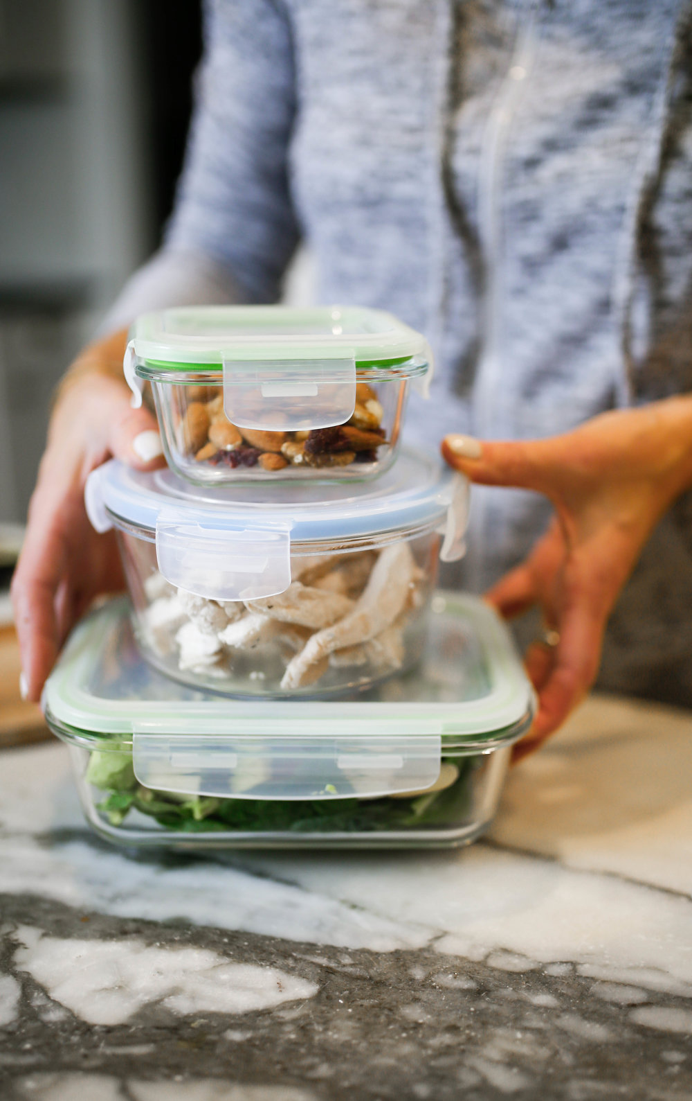 healthy food stacked in glass storage containers