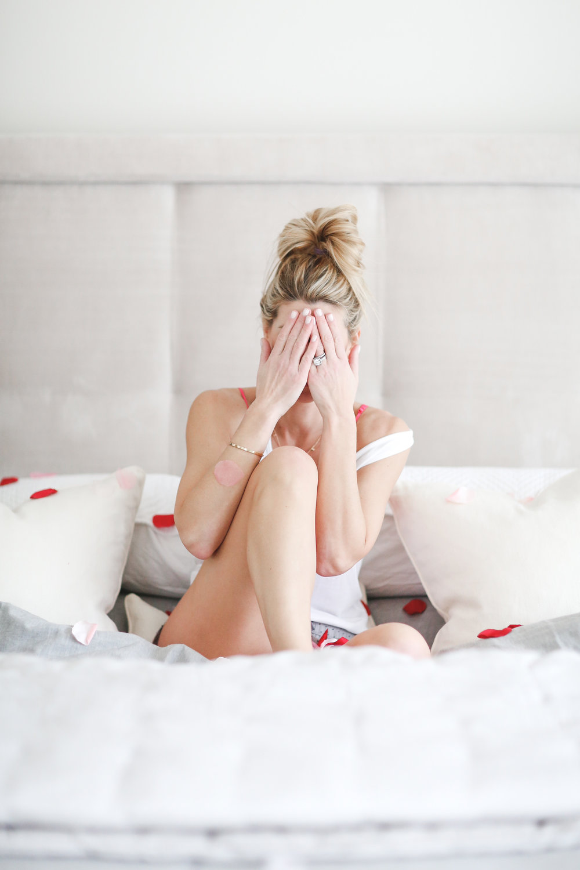 covering eyes sitting on bed.jpg