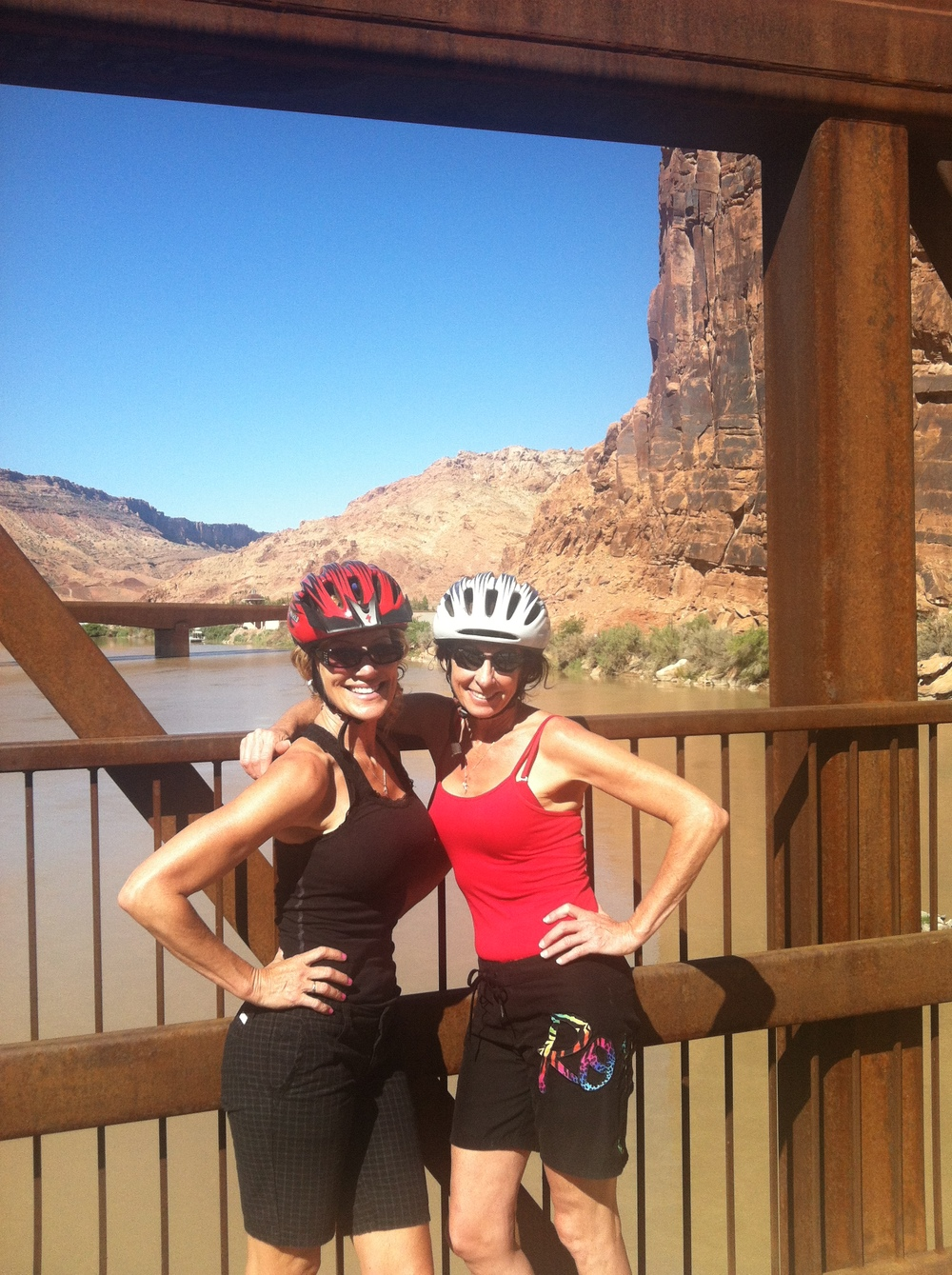Jami Hanna and Vicki Whaley, both 53, mountain biking in Moab, UT.