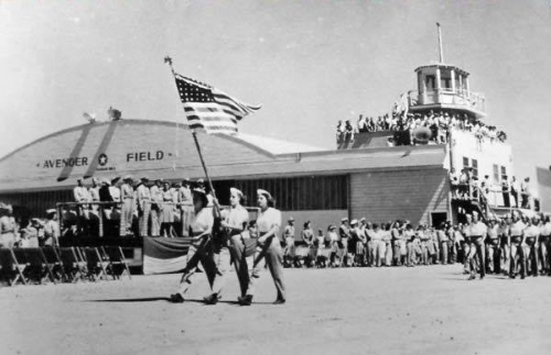 Hangar with parade of WASP
