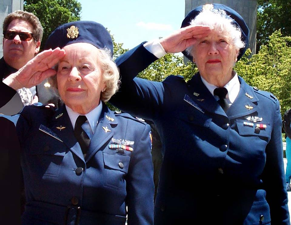 WASP Lorraine Z. Rodgers (left) and Elaine D. Harmon salute during the playing of Taps at an Arlington National Cemetery ceremony honoring women service members. Photo by Sgt. 1st Class Kathleen T. Rhem, USA