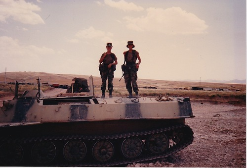 (Kokolis and a friend atop a blown out tank in Iraq)