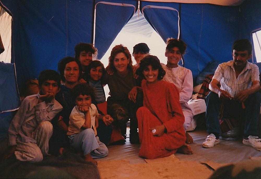 (Nadine Kokolis with a Kurdish family in Iraq)