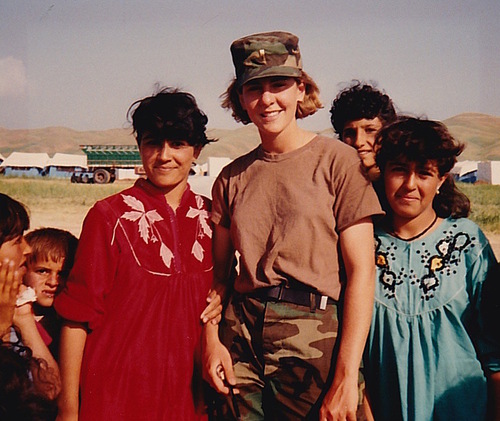 (Kokolis with Kurdish refugees at the camp she helped to build)