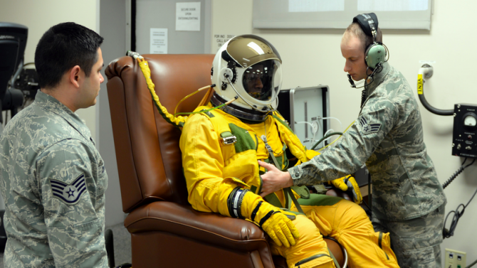 Lt Col Tengesdal undergoes a full pressure-suit maintenance check by airmen from the 9th Physiological Support Squadron Feb. 9, 2015, at Beale Air Force. (Photo: Beale Air Force Base)