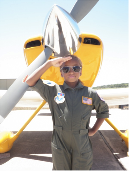 Capt Kenneth Thomas's daughter Dominica after having embarked on her first flight at 8 years old!!  (Photo credit:Kenny Thomas)