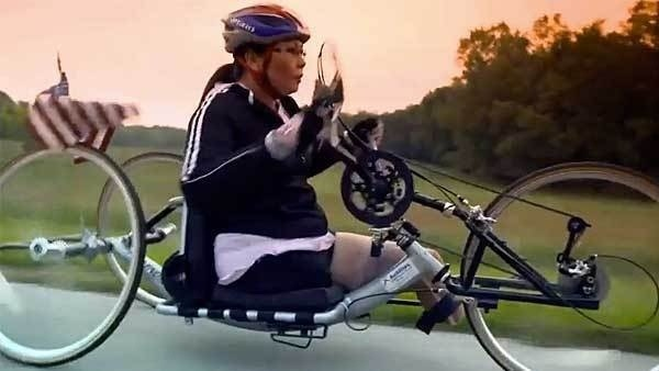 When Tammy Duckworth wanted to show her constituents that she was ready and determined to serve in Congress, she hopped on her bicycle -- her hand-cranked bicycle. (Photo credit: Women Bike: League of American Bicyclists)