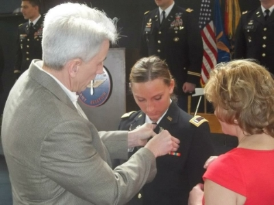 Pearce's mother, a former US Army Nurse, and her father, a former US Army UH-1 Huey pilot, pinning her Aviation wings upon graduating from flight school. (Photo credit: Taylor Pearce)