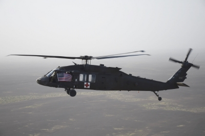 The HH-60M flying over the desert in southern Afghanistan