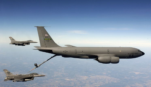 A Boeing KC-135 Stratotanker refueling fighter jets in mid-air. The KC-135 was the USAF's first jet-powered refueling tanker which replaced the KC-97 Stratofreighter. Initially tasked with refueling strategic bombers, it was used extensively in the Vietnam war and later in conflicts like Operation Desert Storm to extend the range and endurance of US tactical fighters and bombers.