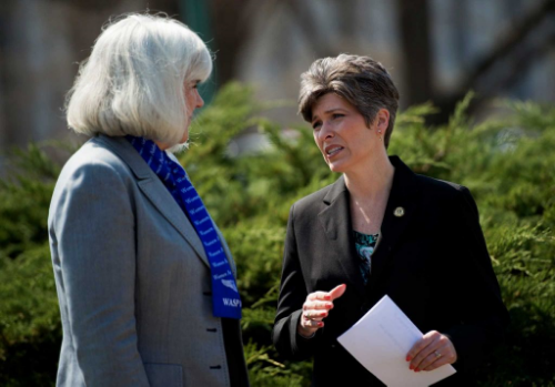 Senator Ernst speaks with Terry Harmon, daughter of WASP Elaine Danforth Harmon, whose family has fought relentlessly to restore inurnment rights for the WASP at Arlington National Cemetery. (Photo credit: TimesUnion.com)