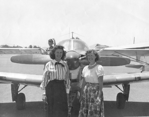 """Upon """"disbandment""""of the WASP, Isabelle returned to nursing, but flew many Powder Puff Derbies in a model 35 Beech Bonanza, which now resides in the Beech Museum in Tullahoma and is the oldest flying Bonanza on record. Here she is with her friend Betty McNeill preparing for a competition. Her son Mike recalls sneaking onto the wing to get into the picture! (Photo credit: Mike McCrae)"""