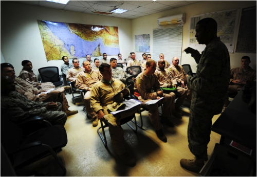 Captain Thomas pictured here with Air Force and Army personnel receiving a crew brief from Colonel Randal Reed, 379th Expeditionary Operations Group Commander, before departing to escort the last ground convoy out of Iraq 18 Dec, 2011. This was the last Joint Surveillance Target Attack Radar System (JSTARS) combat mission over Iraqi air space. The JSTARS provided airborne, stand-off range, surveillance and target acquisition radar and command and control capabilities to ground personnel. (Photo credit: Tech. Sgt. DeNoris A. Mickle)