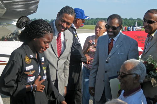 Kimberly Anyadike's emotional meeting with Tuskegee Airman Lieutenant Colonel Herbert Carter (Wheelchair) at Moton Field Tuskegee Alabama. (Photo: Kimberly Anyadike's public facebook page)