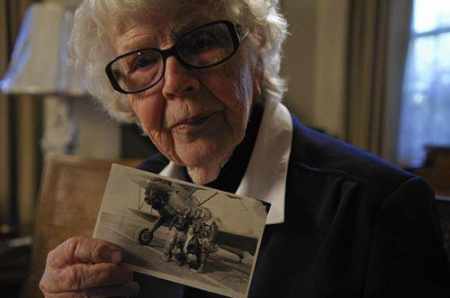 Flora Belle Reece holds a photo of herself serving during WW2.