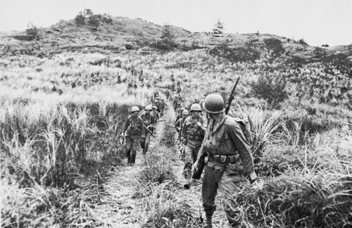 Men of Company B, 305th RCT, moving out from high ground on Guam. (Photo credit: US Army Center of Military History)