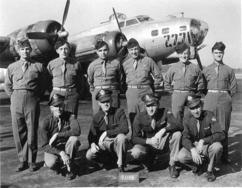 "Robert E. Evans crew, Joined the 100th 8 Jan 1945. L-R kneeling: Robert Evans (P), Robert Bratton (CP), Billie McMillin (NAV), Stephen Zakrzewski (BOM), L-R Standing: Reginald Vinton Bullis (TTE), Robert Merrill (ROG), Robert Parsons (WG) Juel Rudd (TG) Willard ""Jack"" Coop (BTG), Peter Cattilino (WG). He was taken off crew before going overseas, Id courtesy of Jack Coop. (Photo credit: 100th Bomber Group Foundation)"
