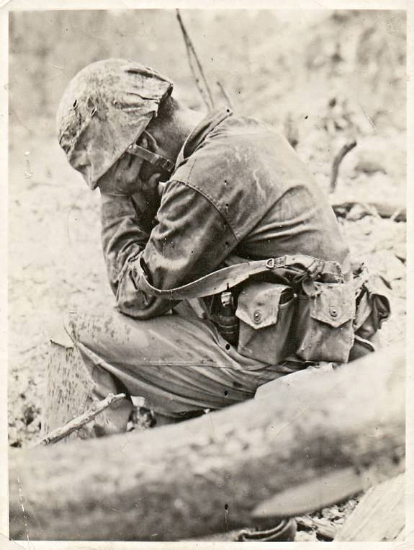 This combat photo, taken during the Battle of Peleliu, depicts a U.S. Marine who weeps after killing a Japanese opponent. (Photo: U.S. Naval Institute)