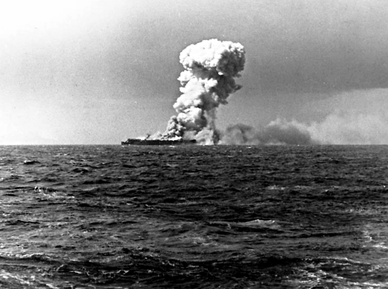 Smoke rises from an explosion on the USS Princeton, 24 October 1944, shortly after being hit by a Japanese bomb while operating off the Philippines. Photographed from USS South Dakota (BB-57).  Official U.S. Navy Photograph, now in the collections of the National Archives.