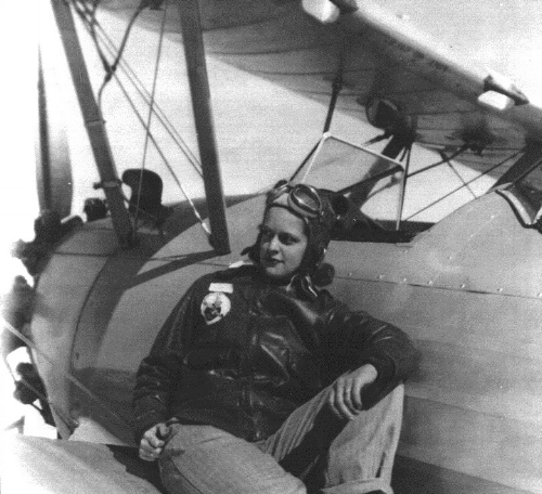 Jane Doyle sits on the wing Stearman PT-17 airplane, circa 1944. (Photo: University of North Carolina Greensboro Digital Collections)