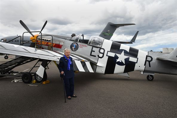 Dorothy Olsen stands in front of a P-51 Mustang on the McChord Field flight line July 10, 2016, at Joint Base Lewis-McChord, Wash. Olsen celebrated her 100th birthday at McChord along with three other WASP, their families and McChord leadership. (Photo: Air Force Photo/Staff Sgt. Naomi Shipley)