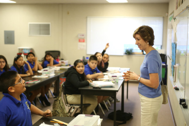 With students at the Animo Ellen Ochoa Charter Middle School in East Los Angeles.  The school is part of the Green Dot public charter school chain. (Photo: Green Dot)