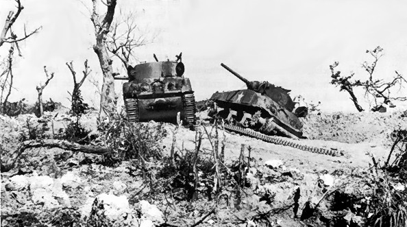 Two U.S. M4 Sherman tanks knocked out by Japanese artillery at Bloody Ridge, 20 April 1945. (Photo: WW2 Archives)