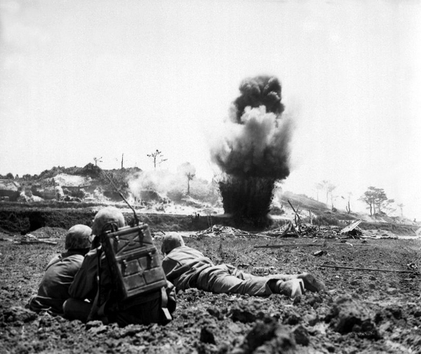 Demolition crew watches explosive charges detonate and destroy a Japanese cave, May 1945. (Photo: WWII Archives)