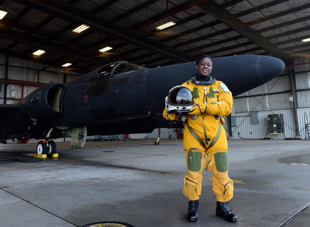 Lt Col Merryl Tengesdal stands in front of a U-2, Feb. 9, 2015, at Beale Air Force Base, Calif. Tengesdal is the only black female U-2 pilot in history. Tengesdal is the 9th Reconnaissance Wing inspector general and a U-2 pilot. (U.S. Air Force photo/Senior Airman Bobby Cummings)