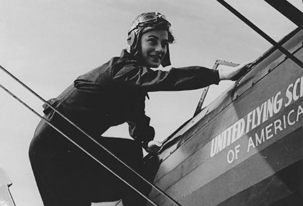 "Iris Critchell climbing into a plane. (Photo: SCPR courtesy of CJ Productions, ""Off-Ramp Recommends: Celebrating Women's History Month with a 96yo WWII Test Pilot"")"