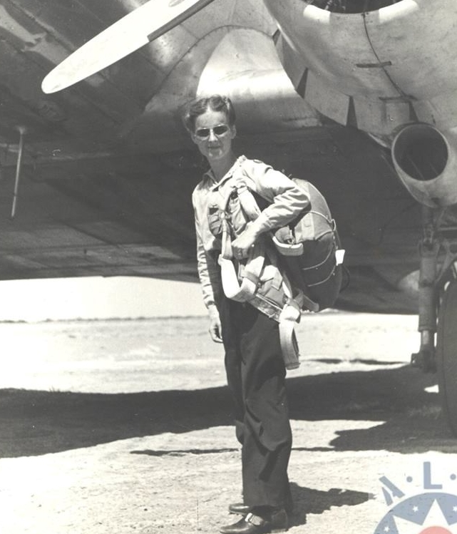 Ruth Adams with her chute posing in front of a C-47 before ferrying it to another base. Courtesy of the American Legacy Museum