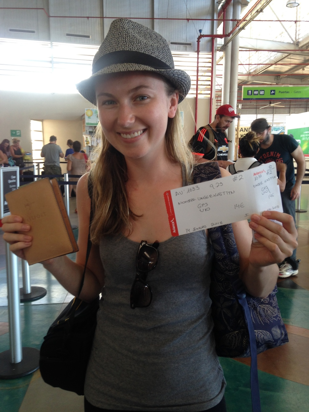 Me and my hand-written boarding pass leaving the Galapagos!
