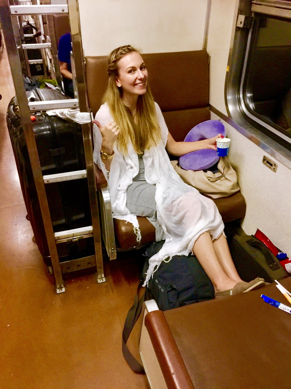 On the seats that fold into the bottom bunk of the night train to Chiang Mai