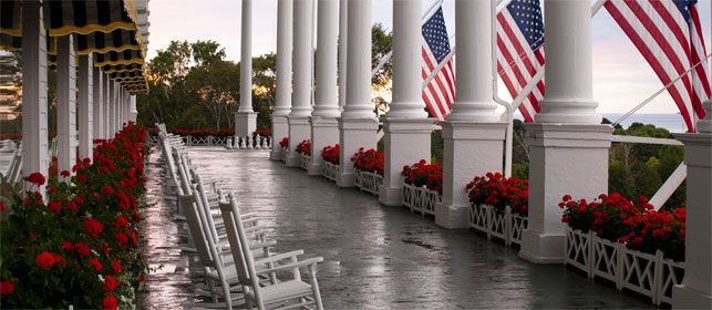 THE GATHERING SPOT : Even more of an island landmark than British-built Ft. Mackinac, the utterly civilized   Grand Hotel   boasts the world's longest front porch, a popular ceremony spot with views of the manicured gardens and waterfront.  (PHOTO: Courtesy of Grand Hotel)