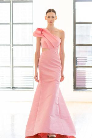 Asymmetrical sculptural drape and cut out.