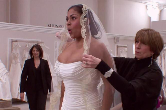 Consultant Sarah Velasquez (center) tries on her dress. TLC