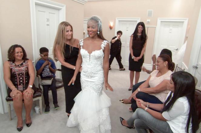 Naulila Diogo (center) during her dress selection. TLC