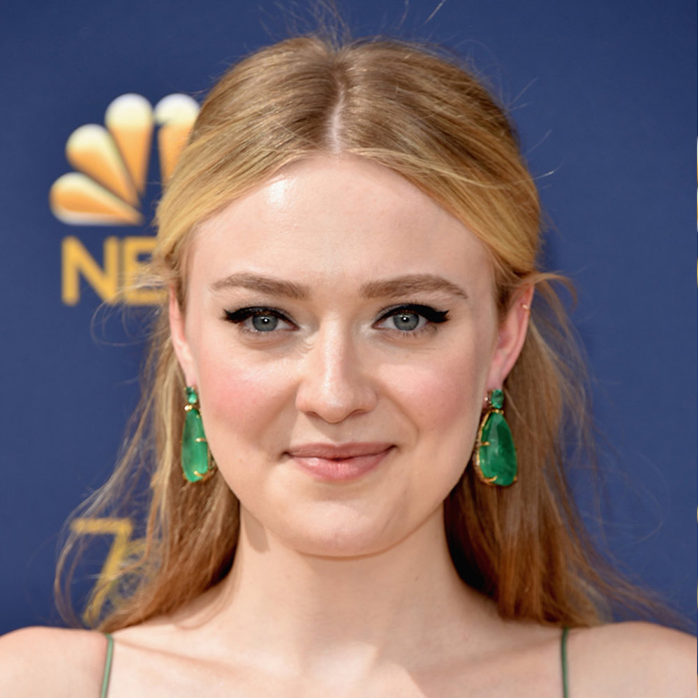 Alienist star Dakota Fanning was a green goddess in a mint-green Dior Haute Couture gown paired with emerald drop earrings that weighed a whopping 175 carats, and matching statement rings, both by Lorraine Schwartz. -
