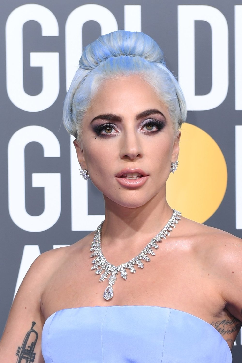 "Clad in voluminous Valentino, the style icon/superstar, Lady Gaga, made a statement in the Tiffany aurora necklace, a custom creation featuring 300 brilliant diamonds, including a 20-carat pear shaped diamond pendant as the centerpiece of the design. She complemented the piece with Tiffany & Co. diamond cluster earrings and three Tiffany diamond bracelets, altogether wearing more than 100 carats of diamonds. Chief artistic officer Reed Krakoff described Gaga as, ""a visionary artist who truly exemplifies creativity and iconic style,"" — and we couldn't agree more. -"