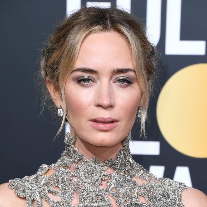 """Emily Blunt: Double Dutch - When it came to concocting an eye-catching 'do for Mrs. John Krasinski, no less than Joan of Arc served as inspo for hairstylist Lainie Reeves, """"Emily's dress was intricately designed and textured, so we aimed to replicate a textured look in her hair as well,"""" said Reeves, who used a fleet of The One by Frédéric Fekkai products and FHI tools to achieve her goal. """"The Dutch braid, also known as a fish tail, was the final look we landed on because it showed femininity but with an undone texture."""" Bonus: the twinkling Neil Lane vintage jewels anchoring the two braids at the back."""