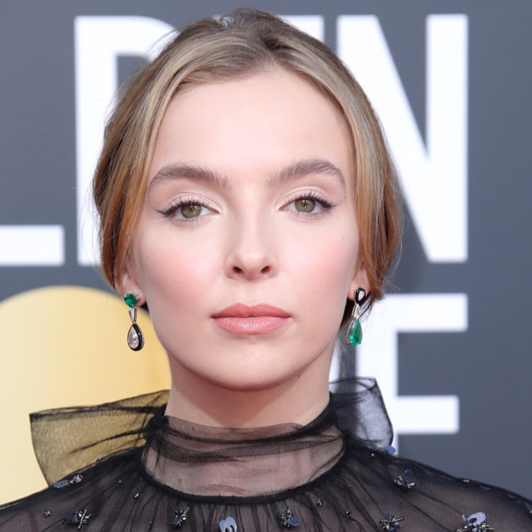 """Jodie Comer: Softly Speaking - It isn't easy to step out of Sandra Oh's shadow, but """"Killing Eve"""" breakout star Jodie Comer managed to draw focus pretty easily Sunday night. How? With a stunning combo pack of feathery brows, mega winged liner and rosy cheeks. Paired with a softly undone updo, the effect was captivating."""