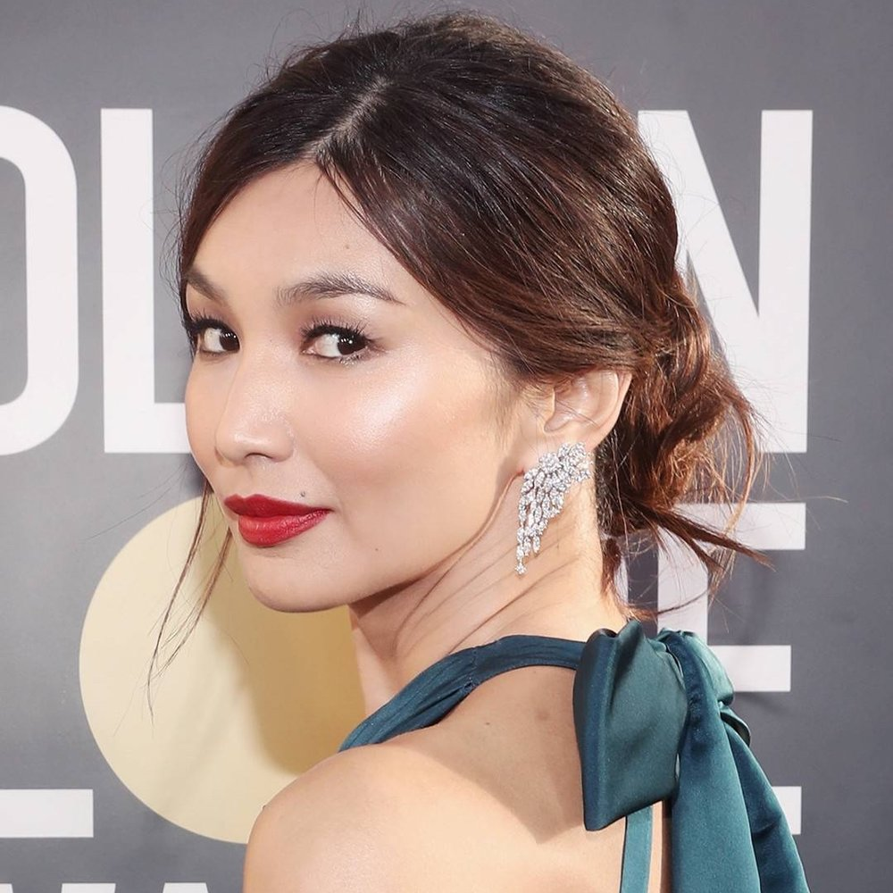 """Gemma Chan: Drop-Dead Red - Girl's on fire, and it's not simply because of the elegant crimson kisser the """"Crazy Rich Asians"""" star sported on the red carpet. Paired with a wispy, ultra-femme bun (courtesy of hairstylist Clariss Rubenstein for Marc Anthony True Professional), Chan delivered a serious knockout punch."""