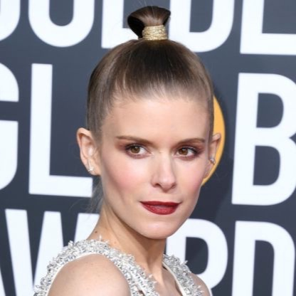 Kate Mara: High & Mighty - Eyes up here, please. While Mara may have been literally busting out of her Miu Miu, we chose to zoom-in on that stellar topknot, executed with extreme precision by hairstylist Ryan Richman. After slicking her strands with OGX Liquid Pearl Shine Serum, Richman swirled the whole scenario with gold glitter twine. All of sudden – bam! – major Mara cheekbones emerge.