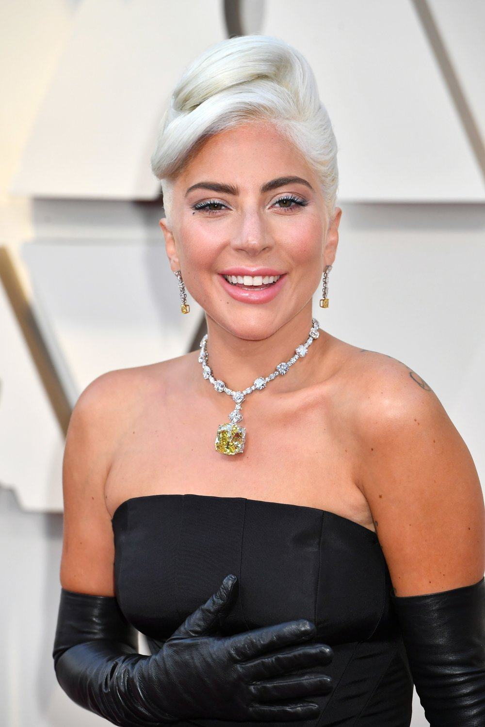 A history-making jewelry moment that only a superstar of Gaga's wattage could pull off: The Best Song winner arrived at the awards ceremony wearing the Tiffany diamond around her neck. The iconic fancy yellow diamond weighs a whopping 128.54 cts. and has not left home since 1961 when Audrey Hepburn wore it for Breakfast at Tiffany's promotional photos. Worn as a pendant hung from a necklace of cushion-cut and round brilliant white diamonds, this was the most talked-about jewel of the night. -