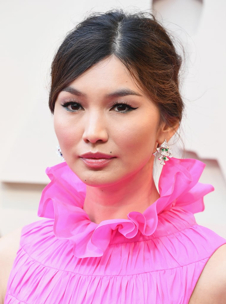 Enveloped in tiers of fuchsia silk ruffles of Valentino Haute Couture, the Crazy Rich Asians star wore Bvlgari's Divas' Dream high jewelry earrings—one with emeralds and diamonds, one with sapphires and diamonds—along with a bracelet made with more than 27 cts. of diamonds and an emerald ring accented with diamonds and rubies. -