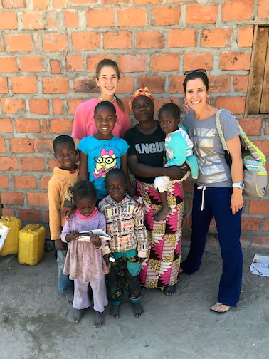 Jennifer and Haley visiting the home of their new sponsored kids!