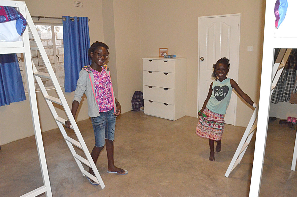 Mary and Doro were most excited about the bunk beds and their first closet ever!